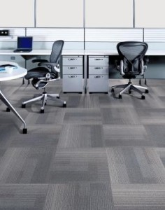 A picture of carpet tiles in an office environment